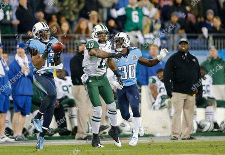 Michael Griffin, Braylon Edwards, Jason McCourty. Tennessee Titans safety Michael Griffin (33) intercepts a pass intended for New York Jets wide receiver Braylon Edwards (17) in the fourth quarter of an NFL football game, in Nashville, Tenn. The Titans won 14-10. At right is Titans cornerback Jason McCourty (30
