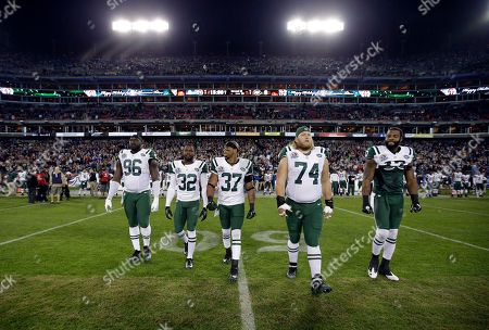 Muhammad Wilkerson, Josh Bush, Yeremiah Bell, Nick Mangold, Braylon Edwards. New York Jets players walk to the center for the field for the coin toss before an NFL football game between the Jets and the Tennessee Titans, in Nashville, Tenn. From left are Muhammad Wilkerson (96), Josh Bush (32), Yeremiah Bell (37), Nick Mangold (74) and Braylon Edwards (17