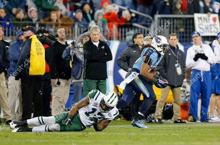 Michael Griffin, Braylon Edwards. Tennessee Titans safety Michael Griffin (33) runs back an interception intended for New York Jets wide receiver Braylon Edwards (17) in the fourth quarter of an NFL football game, in Nashville, Tenn. The Titans won 14-10
