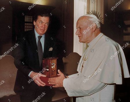John Paul II, Karol Jozef Wojtyla, Edgar Bronfman. In this photo provided by the Vatican, Pope John Paul II receives a gift from Edgar Bronfman, head of the World Jewish Congress, during a private audience at the Vatican, . Bronfman said the pope agreed to join other world leaders supporting a declaration condemning racism and anti-Semitism