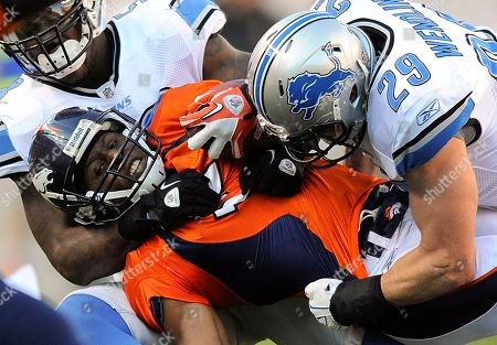 Quan Cosby, John Wendling, Ashlee Palmer. Denver Broncos wide receiver Quan Cosby, center, is tackled by Detroit Lions strong safety John Wendling (29) and linebacker Ashlee Palmer, left, in the third quarter of an NFL football game, in Denver