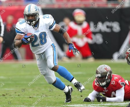Maurice Morris, Geno Hayes. Detroit Lions running back Maurice Morris (28) is brought down by Tampa Bay Buccaneers linebacker Geno Hayes (54) after a first down during an NFL football game between the Buccaneers and the Lions Sunday in Tampa, Fla, . The Lions defeated the Buccaneers 23-20 in overtime