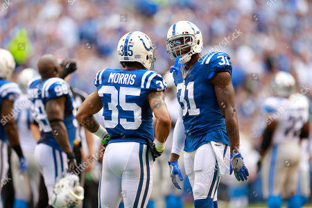 Antonio Cromartie, Darryl Morris. Indianapolis Colts defensive back Darryl Morris (35) talks with defensive back Antonio Cromartie (31) during the first half of an NFL football game against the Detroit Lions in Indianapolis
