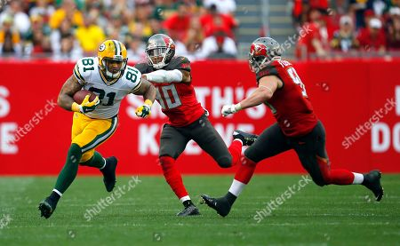 Green Bay Packers tight end Andrew Quarless (81) runs the ball after making a catch against the Tampa Bay Buccaneers during an NFL football game, in Tampa, Fla. The Packers won 20-3