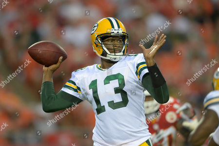 Green Bay Packers quarterback Vince Young (13) looks to throw against the Kansas City Chiefs during the first half of their NFL football game in Kansas City, Mo
