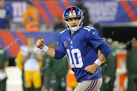 New York Giants quarterback Eli Manning (10) reacts after Brandon Jacobs (34) rushed for a touchdown during the second half of an NFL football gameagainst the Green Bay Packers, in East Rutherford, N.J