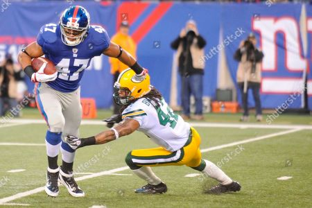 Travis Beckum, Morgan Burnett. New York Giants tight end Travis Beckum (47) is tackled by Green Bay Packers free safety Morgan Burnett (42) during the first quarter of an NFL football game in East Rutherford, N.J