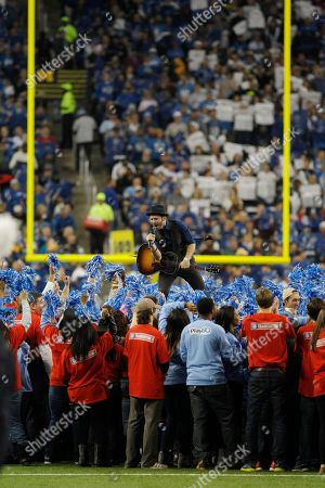 Musician Tony Lucca performs during halftime of an NFL football game between the Detroit Lions and the Green Bay Packers at Ford Field in Detroit