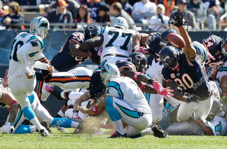Julius Peppers, Olindo Mare, Jason Baker. Chicago Bears defensive end Julius Peppers (90) reaches in to block a field goal attempt by Carolina Panthers' Olindo Mare (10) in the second half of an NFL football game in Chicago, . The holder is Jason Baker (7