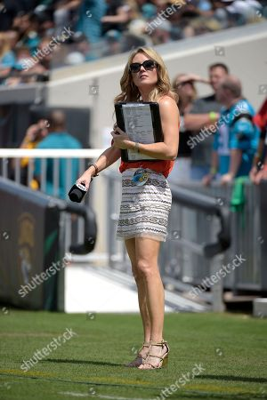 Fox Sports sideline reporter Jennifer Hale watches from the field during the first half of an NFL football game between the Jacksonville Jaguars and the Carolina Panthers in Jacksonville, Fla