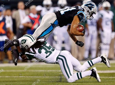Kealoha Pilares, Isaiah Trufant. Carolina Panthers wide receiver Kealoha Pilares (81) is tackled by New York Jets cornerback Isaiah Trufant (35) during the first half of a preseason NFL football game, in East Rutherford, N.J