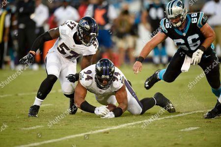 C.J. Mosley, Carl Davis. Baltimore Ravens inside linebacker C.J. Mosley (57) and defensive end Carl Davis (94) chase a fumble by Carolina Panthers quarterback Derek Anderson during the first half of an NFL preseason football game, in Baltimore. Also seen is Carolina Panthers center Gino Gradkowski (66