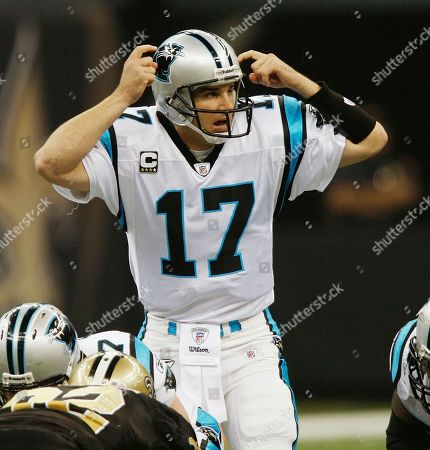 Carolina Panthers quarterback Jake Delhomme (17) calls a play against the New Orleans Saints in the first half of an NFL football game in New Orleans, . [ (AP Photo/Bill Haber
