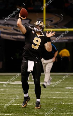 New Orleans Saints quarterback Drew Brees (9) warms up before the start of the Saints Carolina Panthers game in an NFL football game in New Orleans, . [ (AP Photo/Bill Haber