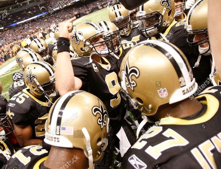 Drew Brese. New Orleans Saints quarterback Drew Brees (9) talks to his team before pregame warmups before the start of the Carolina Panters Saints game in an NFL football game in New Orleans, . [ (AP Photo/Bill Haber
