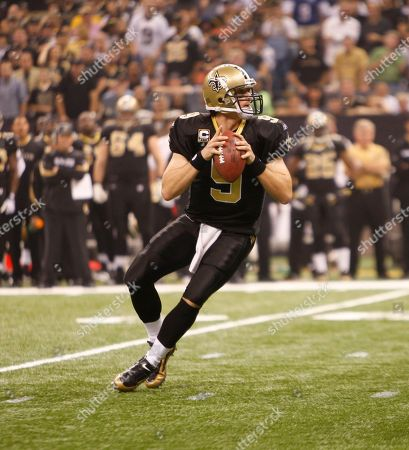 New Orleans Saints quarterback Drew Brees (9) on the sidelines in the first half of an NFL football game in New Orleans, .The Saints defeated the Carolina Panthers 30-20. (AP Photo/Bill Haber