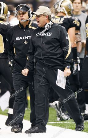 Sean Payton, Greg Williams. New Orleans defenisve coordiantor Greg williams, right, and Saints head coach Sean Payton on the sidelines of the Saints Carolina Panthers game in the first half of an NFL football game in New Orleans, . [ (AP Photo/Bill Haber