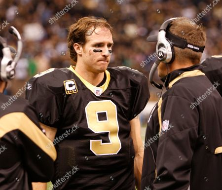 Sean Payton, Drew Brees. New Orleans Saints quarterback Drew Brees (9) talks with coach Sean Payton in the second half of an NFL football game in New Orleans, .The Sainst defeated the Carolina Panthers 30-20. (AP Photo/Bill Haber