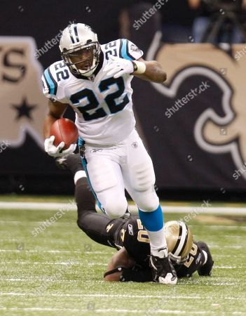 Tyrell Sutton, Randall Gay. Carolina Panthers running back Tyrell Sutton (22) breaks away from New Orleans Saints cornerback Randall Gay (20) in the second half of an NFL football game in New Orleans, .The Sainst defeated the Panthers 30-20. [ (AP Photo/Bill Haber