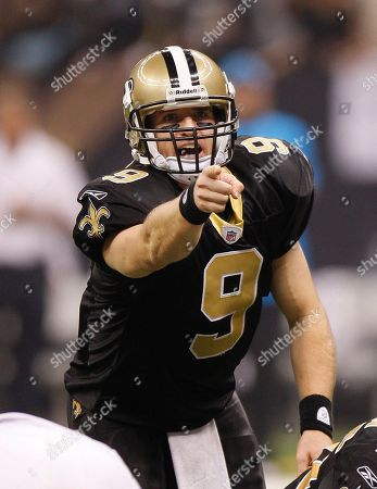 Stock Picture of New Orleans Saints quarterback Drew Brees (9) calls a play against teh Carolina Panthers in the first half of an NFL football game in New Orleans, . [ (AP Photo/Bill Haber