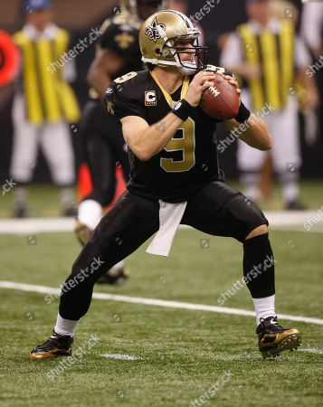 Stock Image of New Orleans Saints quarterback Drew Brees (9) looks to pass in the first half against the Carolina Panthers in an NFL football game in New Orleans, . (AP Photo/Bill Haber