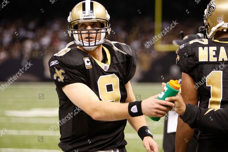 Stock Image of New Orleans Saints quarterback Drew Brees (9) on the sidelines in the second half of an NFL football game in New Orleans, .The Sainst defeated the CarolinaPanthers 30-20. (AP Photo/Bill Haber