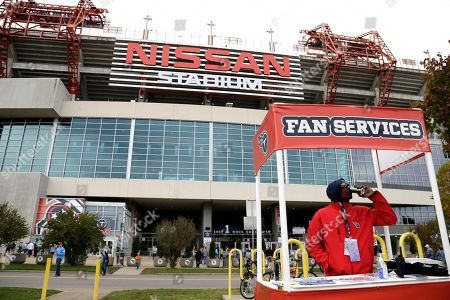 Terry Sanders works in a fan services booth outside Nissan Stadium before an NFL football game between the Tennessee Titans and the Carolina Panthers, in Nashville, Tenn