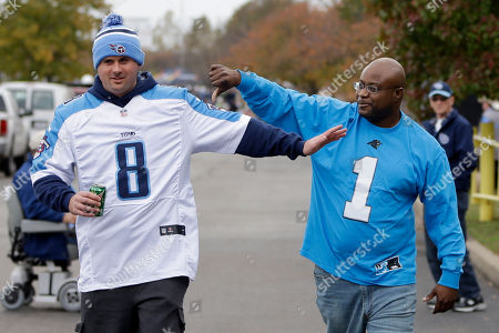 AdamHill, Daniel Thomas. Adam Hill, left, wearing a Tennessee Titans quarterback Marcus Mariota jersey, and Daniel Thomas, right, wearing a Carolina Panthers quarterback Cam Newton jersey, tease one another outside Nissan Stadium before an NFL football game between the Tennessee Titans and the Carolina Panthers, in Nashville, Tenn