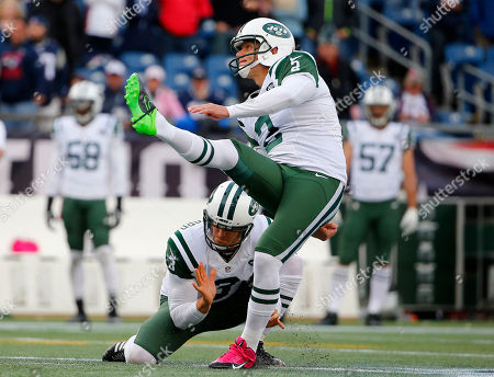 Nick Folk, Steve Weatherford. New York Jets kicker Nick Folk and holder Steve Weatherford watch a field goal against the New England Patriots during a NFL football game at Gillette Stadium in Foxborough, Mass