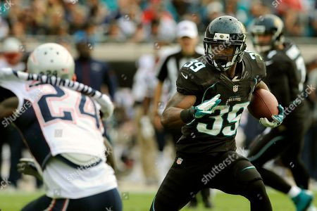 Jacksonville Jaguars running back Richard Murphy (39) runs for yardage during the first half of an NFL football game against the New England Patriots, in Jacksonville, Fla. The Patriots beat the Jaguars 23-16