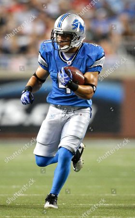Detroit Lions running back Ian Johnson (41) runs the ball during a preseason NFL football game against the New England Patriots in Detroit