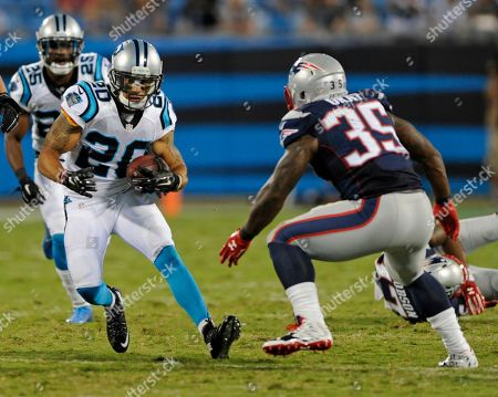 Kurt Coleman, Jonas Gray. Carolina Panthers' Kurt Coleman (20) returns an interception as New England Patriots' Jonas Gray (35) defends during the first half of a preseason NFL football game in Charlotte, N.C