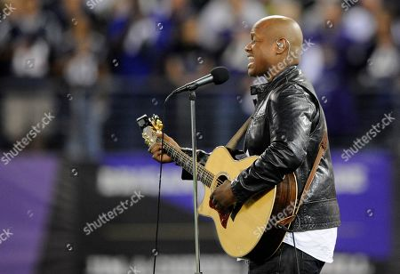 Stock Photo of Javier Colon performs the national anthem as part of the NFL's Hispanic Heritage Month before an NFL football game between the Baltimore Ravens and the New England Patriots in Baltimore