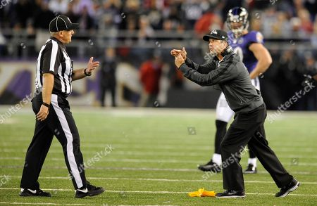 Rodney Russell, John Harbaugh. Baltimore Ravens head coach John Harbaugh, right, speaks with head linesman Rodney Russell in the second half of an NFL football game against the New England Patriots in Baltimore