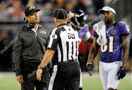 Rodney Russell, John Harbaugh, Anquan Boldin. Baltimore Ravens head coach John Harbaugh, left, speaks with head linesman Rodney Russell as Ravens wide receiver Anquan Boldin (81) looks on during the second half of an NFL football game against the New England Patriots in Baltimore
