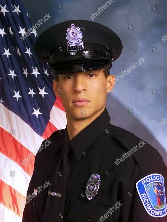 This image provided by the Richmond (Va.) Police Department shows officer Ryan Bailey. The Richmond police chief says an armed suspect who was killed in a shootout with police fired first and his two officers were justified in returning fire. In the Wednesday night, shooting, officer Bailey, who is black, was wounded in the arm. The other officer was Jacob DeBoard