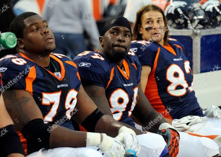Ryan Clady, Daniel Graham, Dan Gronkowski. Denver Broncos offensive tackle Ryan Clady (78), Daniel Graham (89) and Dan Gronkowski (82) look on against the Oakland Raiders during the second half of an NFL football game, in Denver