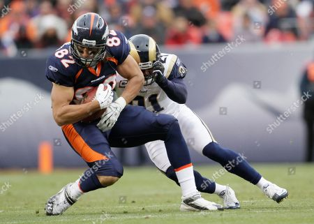 Dan Gronkowski, Oshiomogho Atogwe. Denver Broncos tight end Dan Gronkowski is tackled by St. Louis Rams safety Oshiomogho Atogwe (21) during the first half of an NFL football game, in Denver