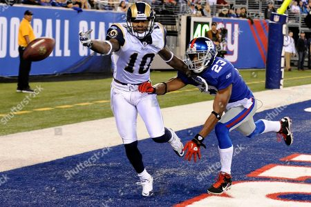 Mike Sims-Walkerm, Corey Webster. St. Louis Rams wide receiver Mike Sims-Walker (10) and New York Giants cornerback Corey Webster (23) chase a pass during the first quarter of an NFL football game, in East Rutherford, N.J
