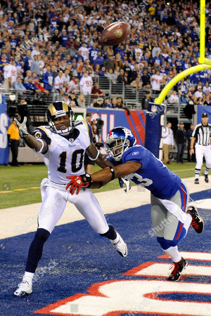 Mike Sims-Walker, Corey Webster. St. Louis Rams wide receiver Mike Sims-Walker cannot catch a pass as New York Giants cornerback Corey Webster defends during the first quarter of an NFL football game, in East Rutherford, N.J