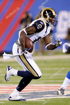 St. Louis Rams' Mike Sims-Walker picks up yardage during the first quarter of an NFL football game against the New York Giants, in East Rutherford, N.J