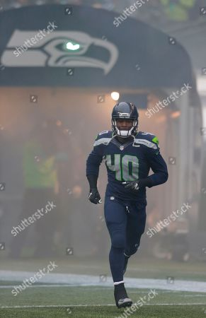 Seattle Seahawks' Derrick Coleman runs onto the field during player introductions before an NFL football game against the St. Louis Rams, in Seattle