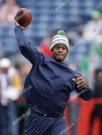 Seattle Seahawks backup quarterback Tarvaris Jackson passes during warmups before an NFL football game against the St. Louis Rams, in Seattle