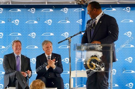 Stock Image of Roger Goodell, Stan Kroenke,James T. Butts Jr. Inglewood Mayor James T. Butts Jr., right, looks back at NFL Commissioner Roger Goodell, left, and Los Angeles Rams owner Stan Kroenke, center, during a ceremony for the groundbreaking of the team's new stadium and entertainment district in Inglewood, Calif. on