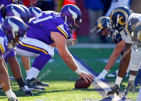 Minnesota Vikings center Joe Berger (61) sets to snap the ball against the St. Louis Rams during an NFL football game, in Minneapolis. The Vikings won in overtime, 21-18