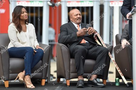 Jim Brown, Monique Brown. Former Cleveland Browns Pro Football Hall of Famer Jim Brown, right, sits with his wife Monique, left, as he is honored with a statue outside FirstEnergy Stadium before an NFL football game against the Baltimore Ravens, in Cleveland