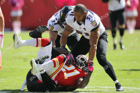 Brendon Ayanbadejo, Javier Arenas. Baltimore Ravens linebacker Brendon Ayanbadejo (51) tackles Kansas City Chiefs defensive back Javier Arenas (21) during the first half of an NFL football game at Arrowhead Stadium in Kansas City, Mo
