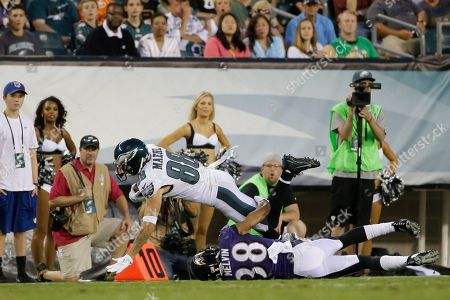 Stock Photo of Philadelphia Eagles' Jeff Maehl (88) collides with Baltimore Ravens' Rashaan Melvin (38) during the first half of a preseason NFL football game, in Philadelphia
