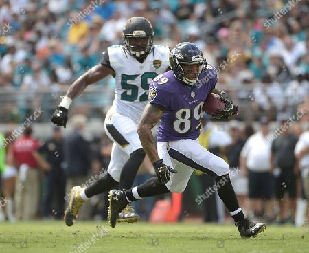 Baltimore Ravens wide receiver Steve Smith (89) runs past Jacksonville Jaguars linebacker Arthur Brown (59) after a reception during the first half of an NFL football game in Jacksonville, Fla