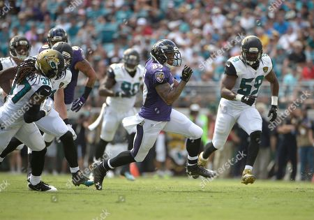 Baltimore Ravens wide receiver Steve Smith (89) runs past the Jacksonville Jaguars defense including Johnathan Cyprien (37) and Arthur Brown (59) during the first half of an NFL football game in Jacksonville, Fla